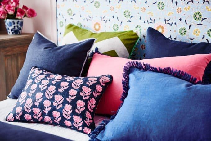 Cushion in Marigold navy, pink.